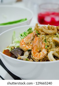 rice noodles with spicy pork ,seafood sauce and vegetable