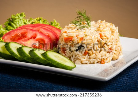 rice on white plate with vegetables