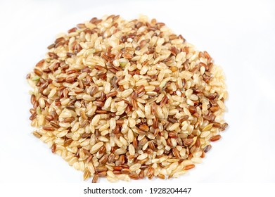 Rice  Phoenix golden. Phoenix rice seeds are a symbol of eternal renewal and immortality. A true source of health and longevity. A mixture of brown and red. Not sanded.