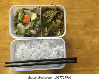 Rice in plastic box. Royalty high quality free stock image of Vietnamese rice in plastic box with chopstick. Officer and worker usually eat rice by take from home