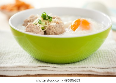 rice porridge with boil pork ,egg,and vegetable thai food
