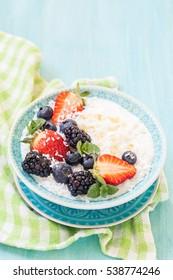 Rice porridge with coconut milk and berries