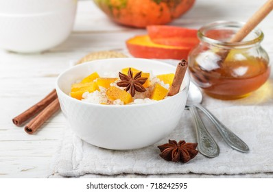 Rice porridge with pumpkin, honey and cinnamon. Healthy Breakfast. Selective focus