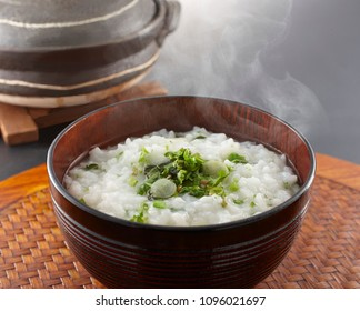 Rice porridge with seven herbs. In Japan, people eat the seven herb rice porridge or 'nanakusa-gayu' on the morning of January 7th./ Rice porridge with the seven herbs with pickled plum, Japanese food