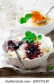 rice pudding with berries jam.selective focus