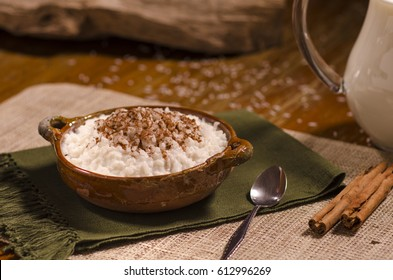 Rice pudding in a clay bowl. called (arroz con leche)