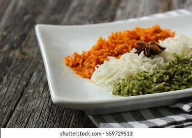 Rice Pulao in Indian flag color / Indian republic day food /  Tiranga(Tri color) rice on wooden background, selective focus
