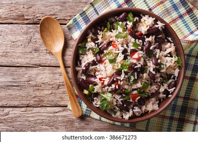 Rice with red beans and vegetables in a bowl on the table. horizontal view from above