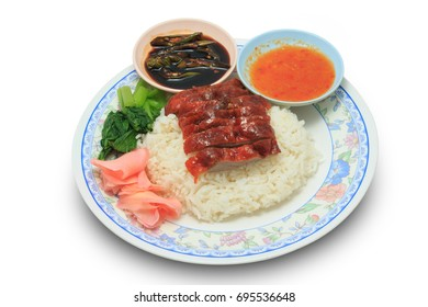 Rice with roasted chicken and vegetable and sauce isolated on white background
