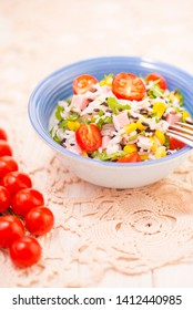 Rice salad with pork steak, tomatoes, corn seeds and tomatoes. Copy space