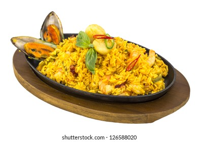 rice with seafood on a hot plate at a restaurant