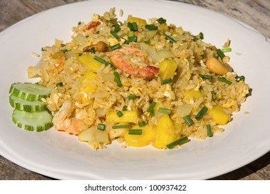 Rice with seafood, pineapple and vegetables on the plate