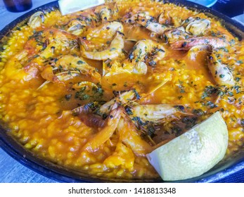 Rice with seafood, prawns, clams and cockles, traditional galician recipe