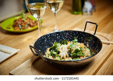rice with seafood vegetables in a frying pan