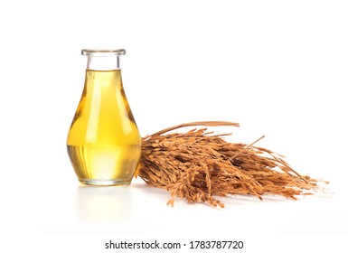 Rice seeds and oil in the bottle on a white background.
