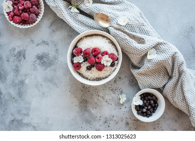 Rice Semilina Breakfast Bowl with Raspberries and Blueberries