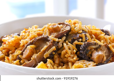 Rice with shitake mushrooms.  This is West African jollof rice.  Delicious, healthy eating.