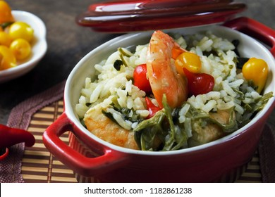 """Rice with shrimp, """"jambu"""" and """"tucupi"""". Typical food from northern Brazil. Cuisine of indigenous origin.  Close-up photography."""