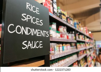 Rice, spices, condiments, sauces signage grocery categoy aisle at supermarket