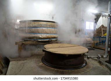 Rice steaming old fashion process of making Sake liqour in local vinatge brewery house of Janpan