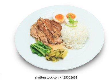 Rice with stewed pork leg and vegetable and duck egg isolated on white background