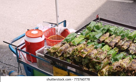 Rice sticky filled with sweet banana and wrapped with banana leaf were grilled for sale at Yaowarat, Bangkok, Thailand, a popular Chinese street food in Thailand