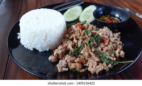 Rice with stir-fried pork and basil ,Thai food.