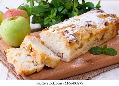 Rice sweet casserole with apples on a wooden board