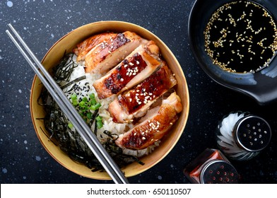 Rice with teriyaki chicken grill or teriyaki don in Japanese style set and ready to eat  in studio lighting,