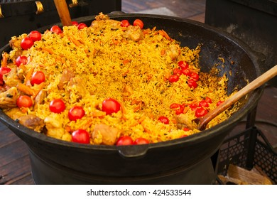 Rice with tomatoes and meat in a big bowl, pilaf. Traditional Middle Eastern dish. Street food