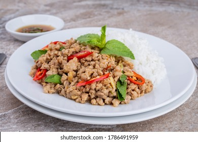 rice topped with stir-fried mince pork and basil , Thai famous Street food