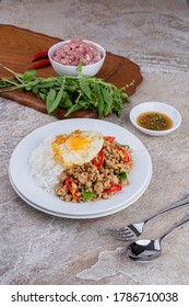 rice topped with stir-fried mince pork and basil with fried egg , Thai famous Street food