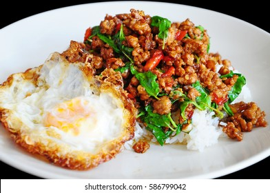 Rice topped with stir-fried minced pork and basil with Fried egg