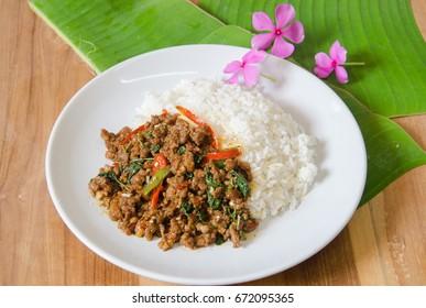 "Rice topped with stir-fried pork and basil, Thai food ""pad kra pao""."