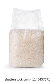 Rice in transparent plastic bag isolated on white background