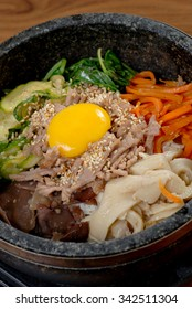 Rice with vegetable in hot bowl Korean food