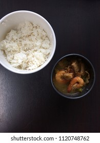 Rice in white cup and  Sour soup made of Tamarind Paste with shrimp