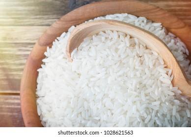 rice in wooden utensils