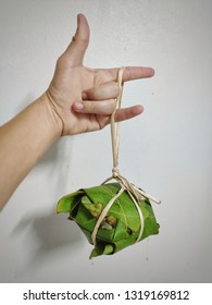 Rice wrapped in banana leaves