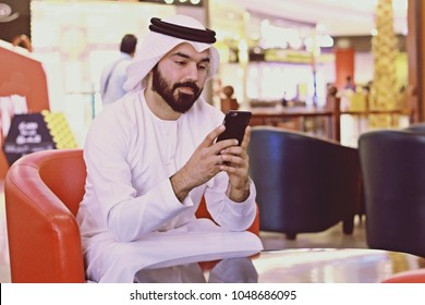 Rich Arab Business Man Using Internet Mobile Phone In A cafe Shop
