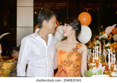 Rich Asian Couple at socialite's birthday party at a five-star hotel. Jakarta, October 14, 2015
