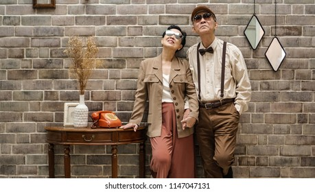Rich Asian senior couple vintage fashion in luxury home