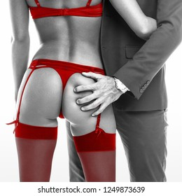 Rich boss grab sexy lover ass black white red selective coloring, closeup, seduction, isolated on white