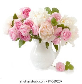 Rich bunch of peonies and tea roses in vase isolated on white