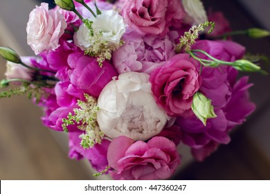 Rich bunch of pink peonies and lilac eustoma roses flowers