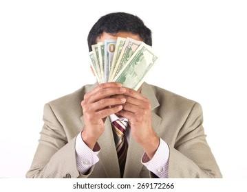 Rich businessman hiding behind american dollars