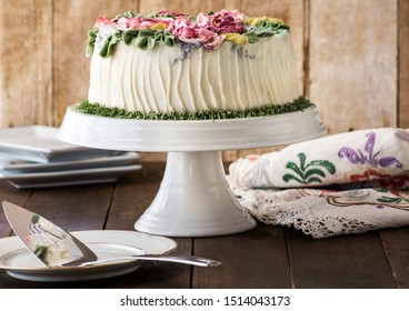 Rich Buttercream Flowers on Festive Cake