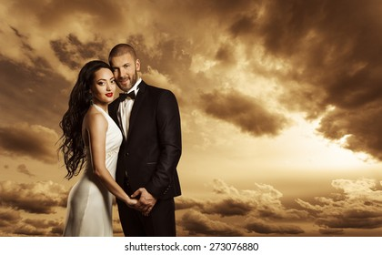 Rich Couple Portrait, Elegant Woman Dress and Man Suit with Bow Tie, Fashion Beauty over Evening Sky