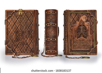 """Rich decorated handmade leather bound journal named """"Anatomia"""" captured in stand up position from the right side"""