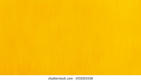 Rich egg yolk yellow coloured slightly textured background with copyspace